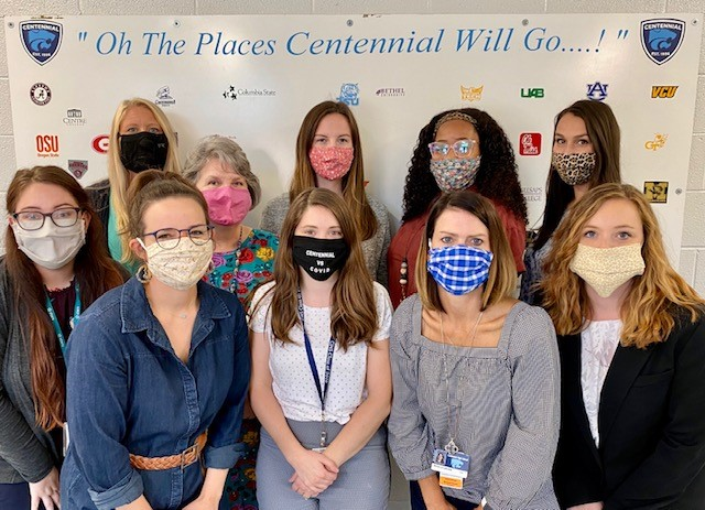 The entire Centennial Counseling Team, wearing their Covid masks, posing for a group shot in front of the Counseling Center.