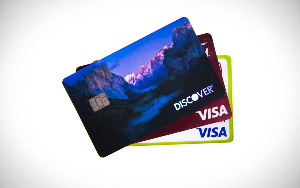 An image of Discover, Mastercard, and Visa cards in a fan layout.