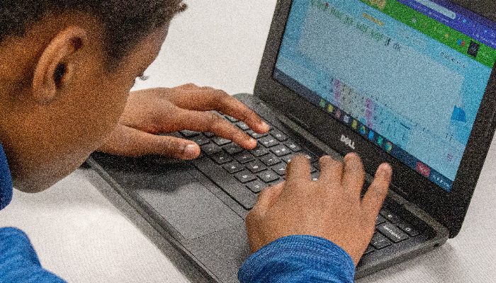 Student focused on a laptop