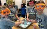 Students working with science goggles on