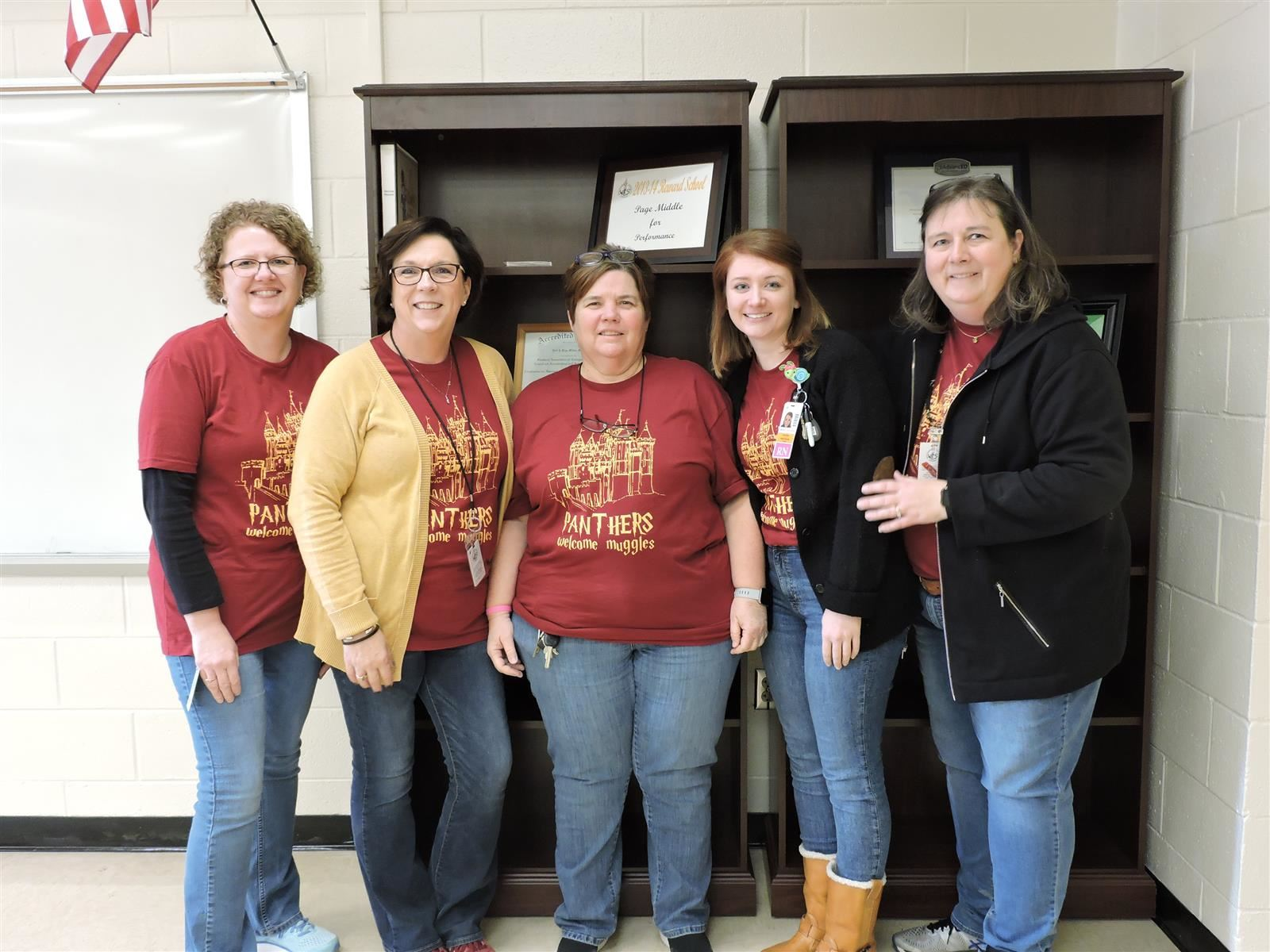 Front office staff group of five standing together