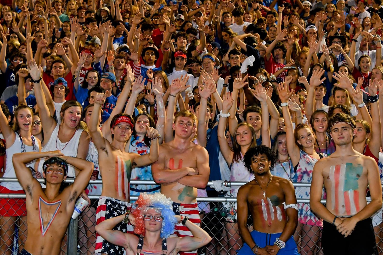 Student's cheering in the stands at a Page High football game.