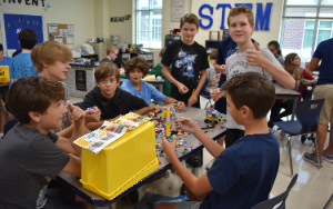 Kids enjoy Legos during STEM Express class.