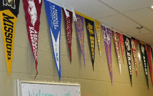 college flags hanging in counseling office