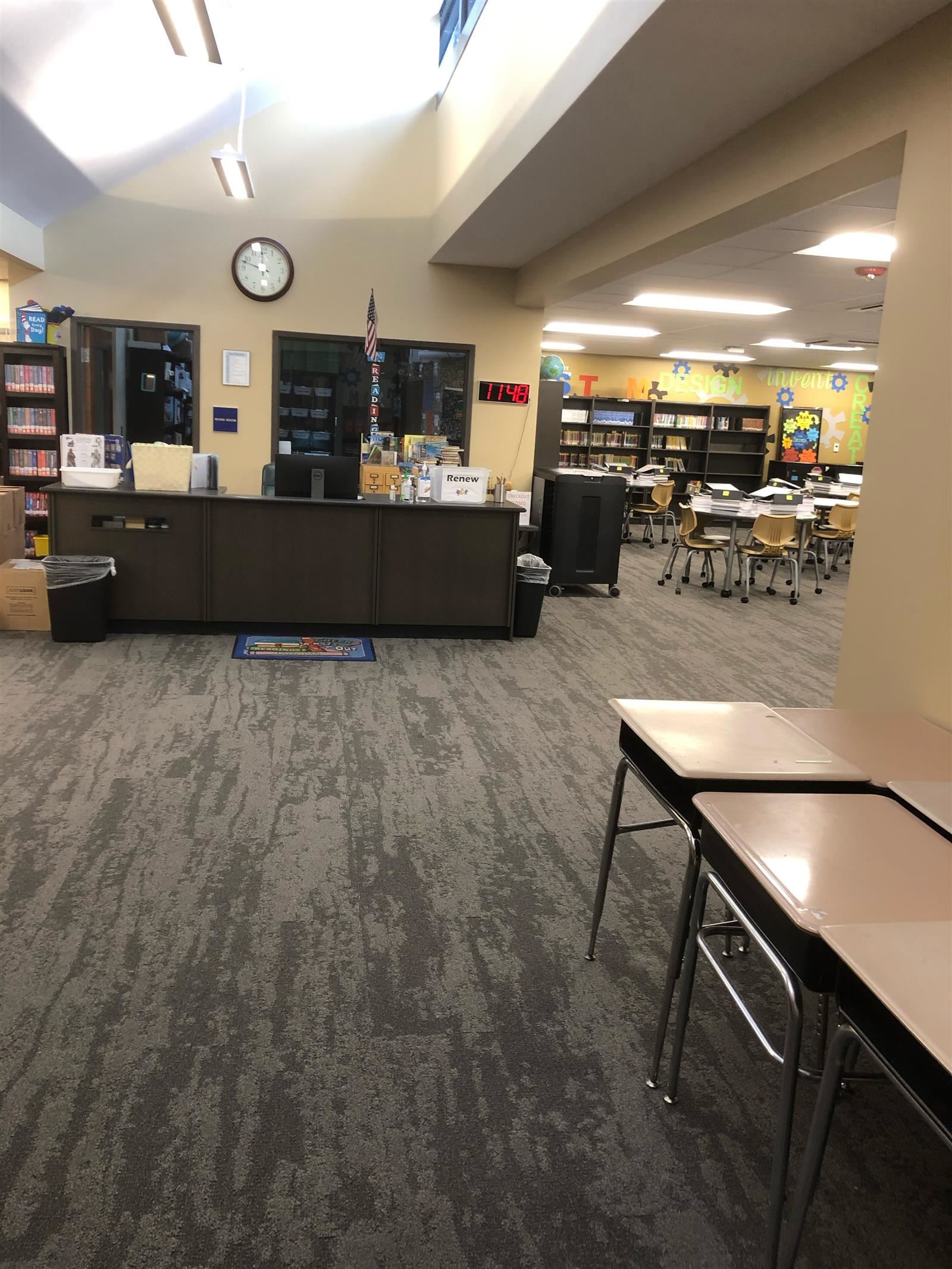 Scales Elementary learning common entrance with circulation desk and books